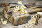 Old carpenter's hammer with other carpentry tools — Stock Photo