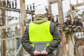 Electrical Engineer with tablet PC in electrical substation — Stock Photo