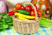 Peppers, tomatoes with spring onions and parsley in basket — Stock Photo