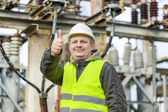 Electrician with outstretched hand with thumb up — Stock Photo