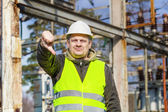 Electrician with outstretched hand with thumb down — Stock Photo