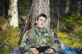 Sleeping recruit with tablet PC — Stockfoto