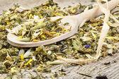 Herbal tea on spoon — Stock Photo