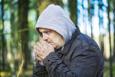 Man with a rosary — Stock Photo