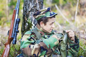 Young recruit near tree — Stok fotoğraf