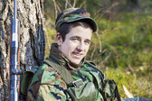 Young recruit near tree — Stock fotografie
