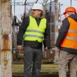 Two electrical workers in the electric substation — Stock Video