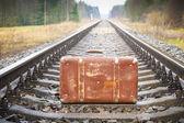 Old suitcase on the railway — Stock Photo