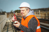 Worker with canned meat on a railway — Stock Photo