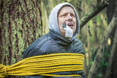 Man tied to the tree — Stock Photo