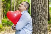 Man holding red balloon — Stock Photo