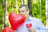 Man with red balloons — Stock Photo