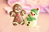 Gingerbread man and woman of chocolate — Stock Photo