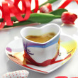 Valentine - cup of coffee with cloth hearts — Stock Photo #18934515