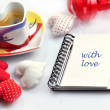 Valentine diary with cloth hearts and cup of coffee — Stock Photo #18934851