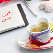 Valentine diary with cloth hearts and cup of coffee — Stock Photo
