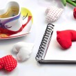 Valentine diary with cloth hearts and cup of coffee — Stock Photo #18957943