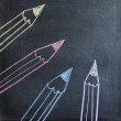 Hand drawn colorful pencils on chalkboard — Stock Photo