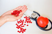 Hand for red pill and healthy living — Stock Photo