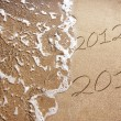 New Year 2013 is coming - numbers written in sand on exotic beach — Stock Photo