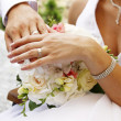 Hands and rings on wedding bouquet — Stock Photo #15388915