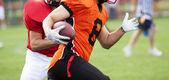 American football players fighting for the ball — Stock Photo