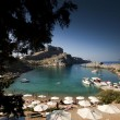 Postcard from torquois hidden bay in Rhodes Greece - Stock Photo