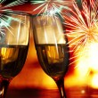 Stock Photo: Glasses with champagne against fireworks