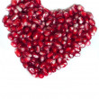 Heart shaped pomegranate seeds — Stock Photo #18525681