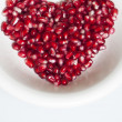 Heart shaped pomegranate seeds — Stock Photo #18525683