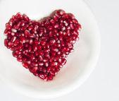 Heart shaped pomegranate seeds — Stock Photo