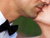 Close up portrait of young caucasian couple kissing — Stock Photo