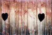 Vintage photo of two hearts in wood — Stock Photo