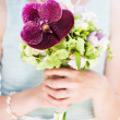 photo of bride holding colorful wedding bouquet — Stock Photo
