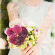 Bride holding colorful wedding bouquet  — Stock Photo