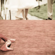 Red bridal shoes and barefoot bride in the background — Stock Photo #26304995