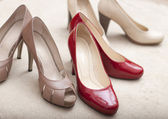 Three pairs of elegant woman shoes — Stock Photo