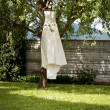 Stock Photo: Wedding dress hanging on a tree