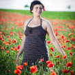 Stock Photo: Young pregnant woman in poppy field