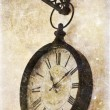 Vintage photo of old clock hanging on wall — Stock Photo