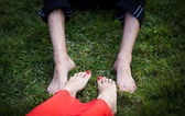 Bride and groom with their feet — Stock Photo