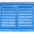 Old window with blue shutters — Stock Photo