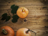 Pumpkins on a wooden vintage background — Stock Photo