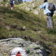 People trekking in mountains — Stock Photo