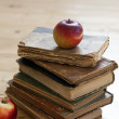 Old books and red apple  — Stock Photo