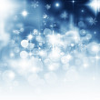 Light abstract Christmas background with white snowflakes — Stock Photo