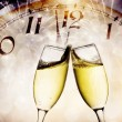 Wine glasses and clock at midnight — Stock Photo
