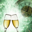 Champagne glasses with clock and fireworks — Stock Photo