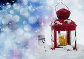 Christmas snowman and red lantern — Stockfoto
