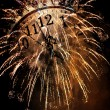 Old vintage clock and fireworks — Stock Photo